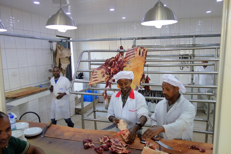 Kitfo butchers happily chopping away.