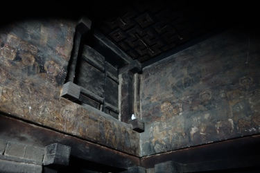 Faded church paintings inside Yemrehanna Kristos.