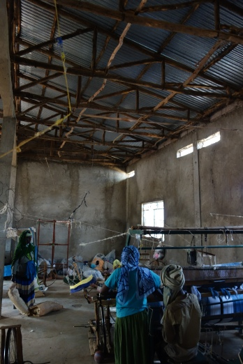 Men and women weave together in Awra Amba's textile factory.