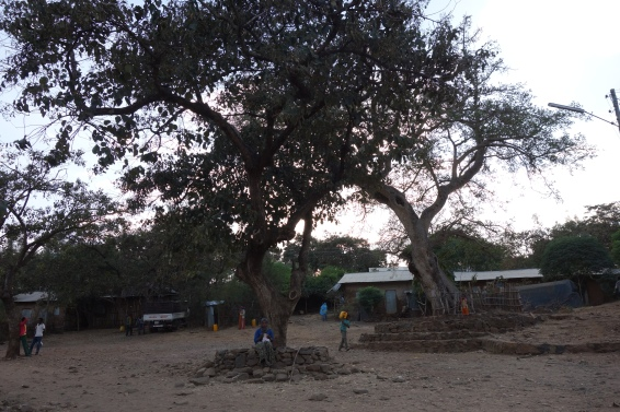 The village centre at dusk, where people come to chat with one another.