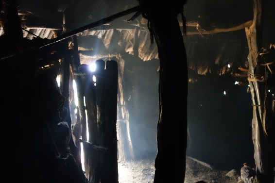 Sunlight pierces through any cracks in the family's hut. There was no light inside (not even a battery-powered torch).