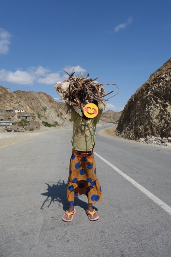 A young girl carrying firewood from out of town. Again, she insisted I take her photo and was very pleased with the result!