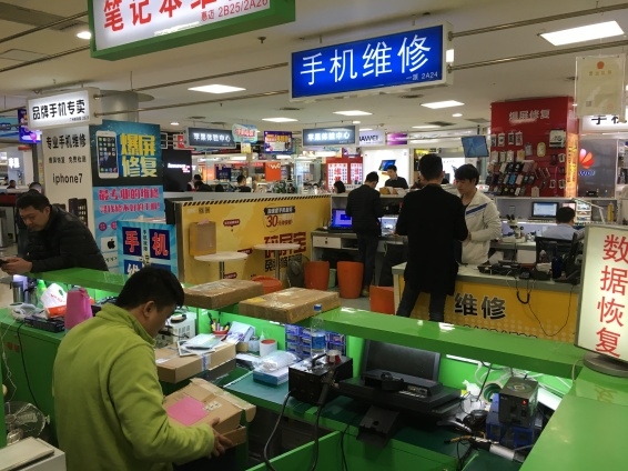 People make and repair phones and tablets at the Gangding Computer Markets.