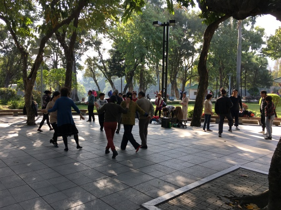 Old ladies having a morning linedance at Liwan Park.