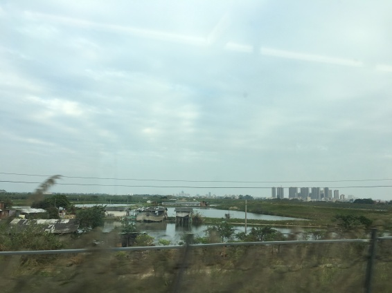 Highrise development encroaches on the Pearl River Delta's dwindling farmlands. Not the difference in living standards.