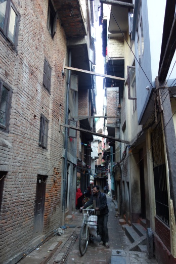 Many tight laneways have braces spanning from building to building in the aftermath of the 2015 earthquake.