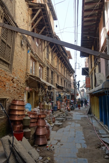 Copperware merchants in the backstreets of Patan.