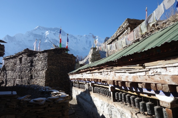 A mani wall in Ghyaru with the Annapurna Massif in the background.