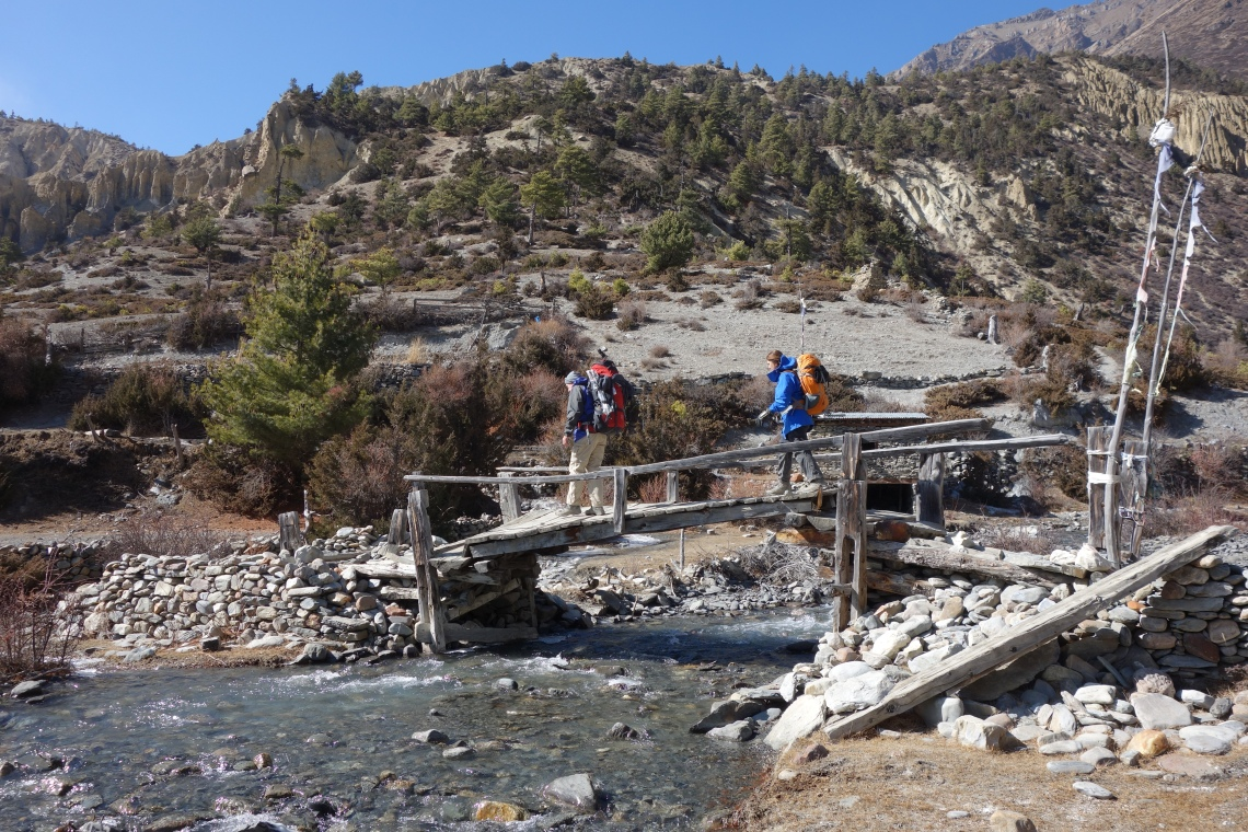 trekking in nepal river bridge travel blog