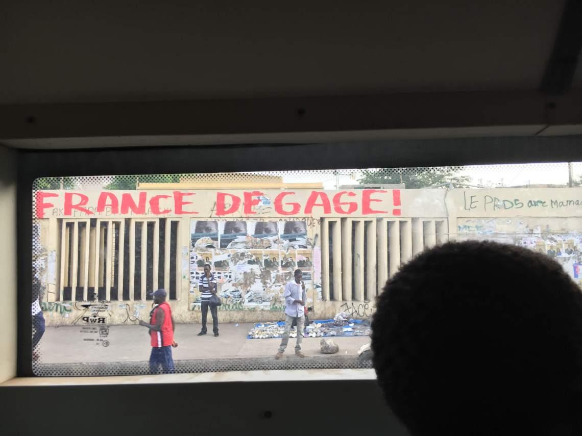 dakar senegal political graffiti france degage