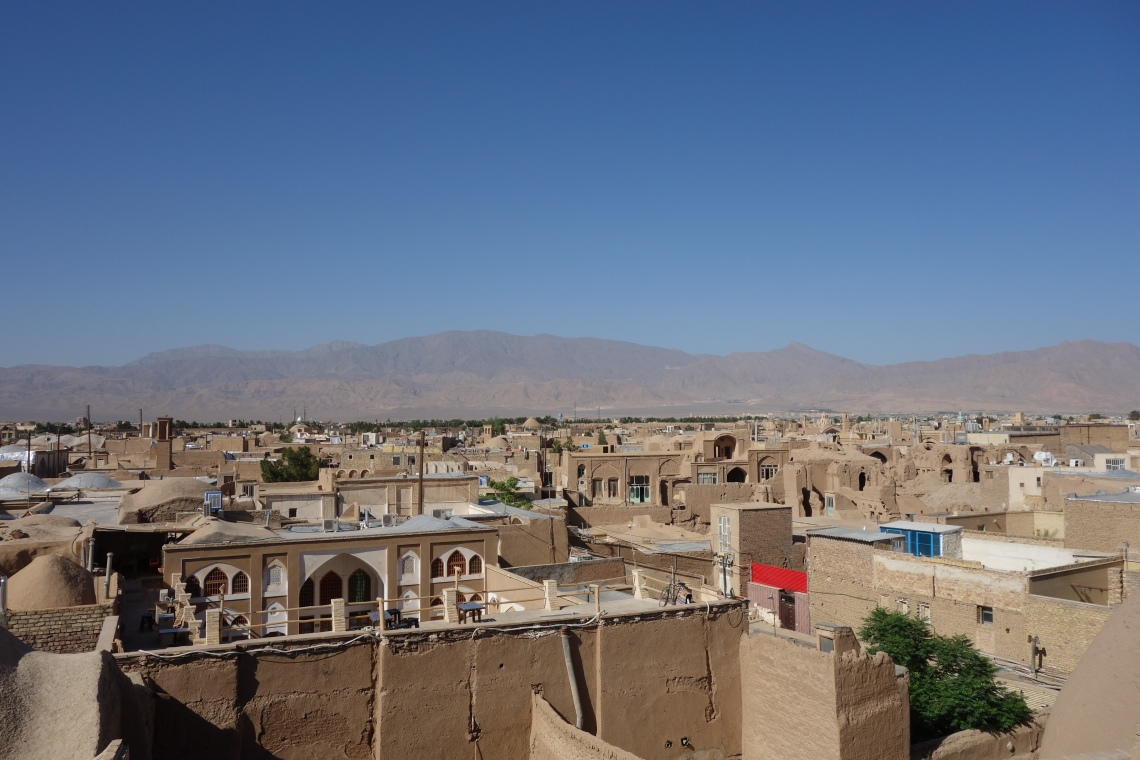 kashan rooftops mountains iran travel blog