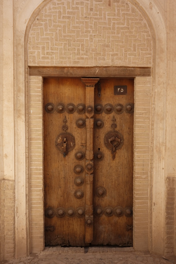 Male and female doorknockers in Kashan.